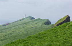 Landscape and lighthouse on Faroe islands. Royalty Free Stock Photos