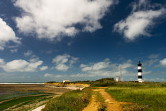 Landscape and lighthouse Island Oleron in France. Island D'Oleron in the French Charente with striped lighthouse royalty free stock photo