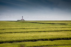 Landscape with lighthouse at North Sea Stock Photos