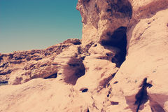 Landscape, Limestone precipice with cave with Instagram style fi Royalty Free Stock Images