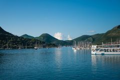 Landscape of a little harbour with blue ocean and sky and white. Boats in Lefkda, Greece stock image