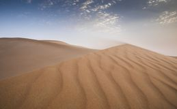 Sandstorm in a desert. Landscape of Liwa desert at sunset, part of Empty Quarter desert, the largest continuous sand desert in the world royalty free stock photography