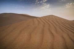 Sandstorm in a desert. Landscape of Liwa desert at sunset, part of Empty Quarter desert, the largest continuous sand desert in the world royalty free stock image