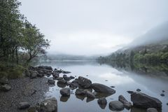Landscape of Llyn Crafnant during foggy Autumn morning in Snowdo Royalty Free Stock Image