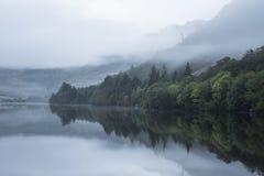 Landscape of Llyn Crafnant during foggy autumn morning in Snowdo Stock Photos