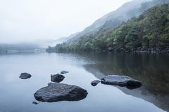 Landscape of Llyn Crafnant during foggy Autumn morning in Snowdo Royalty Free Stock Photography