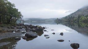 Landscape of Llyn Crafnant during foggy autumn morning in Snowdo Stock Images