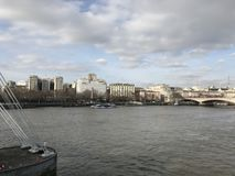 London River Thames with Bridge and landmarks in the background. Landscape of London City / Town looking over the River Thames with landmarks in the background stock images