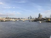 London River Thames with Bridge and landmarks in the background. Landscape of London City / Town looking over the River Thames with landmarks in the background stock image