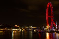 Landscape of London eye and Thames river at night view from Westminster bridge Royalty Free Stock Images