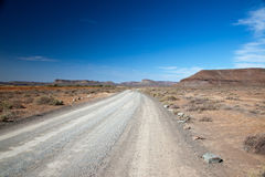 Landscape with a lonely road or lane Stock Photos