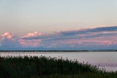 Landscape long bridge over a sea plait on a beautiful pink sunse Stock Images