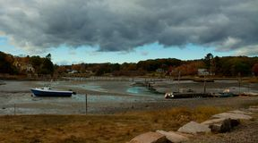 Storm Clouds over boats at low tide Royalty Free Stock Images