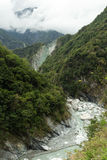 Landscape of lush mountains, ravine and a river Stock Image
