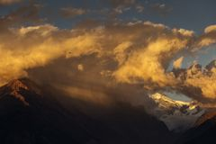 Landscape with Machapuchare-Fishtail peak at sunset view from Ghandruk during trekking in Himalaya Mountains, Nepal.  stock images