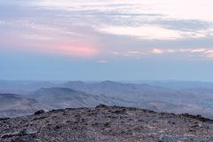 Landscape of magic sunrise over israel judean desert. Morning sky, clouds and sun, mountains and ruins, infinite nature on holy land Royalty Free Stock Image