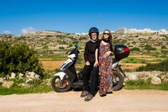 Landscape of Malta with tourists. Beautiful landscape of Malta island and couple of young caucasian tourists traveling on motorbike. Beautiful landscape in south Stock Images