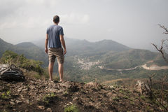 Landscape with man in Amedzofe, Volta Region, Ghana. Beautiful landscape with a man overlooking the valley in the mountains in Amedzofe in the Volta Region Stock Image