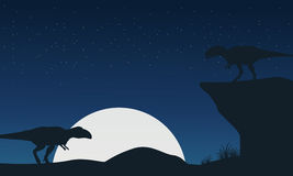 Landscape of mapusaurus dinosaur silhouettes Royalty Free Stock Photo