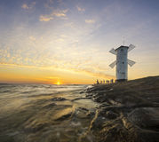 Landscape marine lighthouse in the shape of a windmill Royalty Free Stock Photo