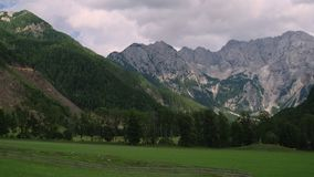 Landscape with meadow and Alps mountains. In summer day stock video footage