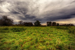 Landscape with meadow and dramatic sky Royalty Free Stock Photo