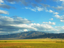 Landscape with meadow and  mountain Royalty Free Stock Images