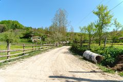 Landscape Meadow View of Village with Houses Stock Image