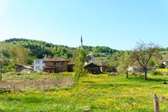 Landscape Meadow View of Village with Houses Royalty Free Stock Photo