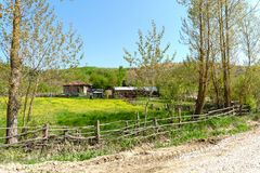 Landscape Meadow View of Village with Houses Royalty Free Stock Photos