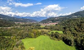 Landscape with meadows, mountains and clouds. Italy stock photo