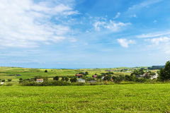 Landscape of meadows with several farms in Cantabria, Spain Royalty Free Stock Photo