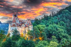Landscape with medieval Bran castle known for the myth of Dracula at sunset. Brasov landmark, Transylvania, Romania, Europe royalty free stock photo