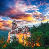 Landscape with medieval Bran castle known for the myth of Dracula at sunset. Brasov landmark, Transylvania, Romania, Europe royalty free stock images