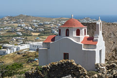 Landscape with medieval fortress and White church, Mykonos island, Greece Stock Photos