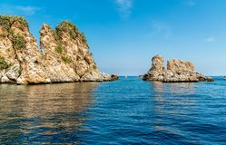 Landscape of Mediterranean sea with Faraglioni of Scopello at Zingaro Nature Reserve, Sicily royalty free stock images