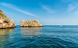 Landscape of Mediterranean sea with Faraglioni of Scopello at Zingaro Nature Reserve, Sicily Royalty Free Stock Photography