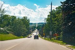 Free Landscape Midday View Of Canadian Ontario Country Side Road With Cars Traffic During Sunny Day With White Clouds In Blue Sky. Royalty Free Stock Images - 152593069
