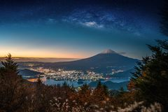 Landscape with Milky way galaxy. Mt. Fuji over Lake Kawaguchiko royalty free stock photos