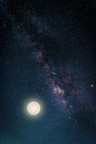 Landscape with Milky way galaxy. Night sky with stars and the full moon. (Elements of this moon image furnished by NASA) stock photo