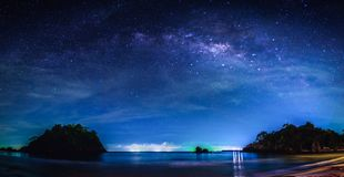 Landscape with Milky way galaxy. Night sky with stars and milky. Way over sea and mountain stock photos