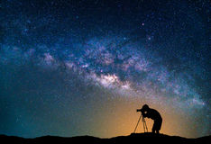 Landscape with Milky way galaxy. Night sky with stars and Photog. Rapher take photo on the mountain Stock Images