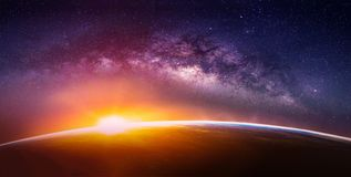 Landscape with Milky way galaxy. Sunrise and Earth view from space with Milky way galaxy. Elements of this image furnished by