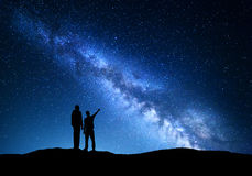 Landscape with Milky Way. Silhouette of a father and son Stock Photography