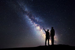 Landscape with Milky Way. Silhouette of a father and son Royalty Free Stock Images