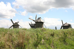 Landscape with mills. Against the cloudy sky Stock Image
