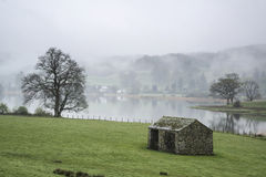 Landscape on misty morning of fields around Lake Windermere in L Royalty Free Stock Photo