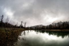 Landscape with misty morning fog in the Forest Lake or Beautiful forest lake in the morning at winter time. Azerbaijan nature. Caucasus Stock Image