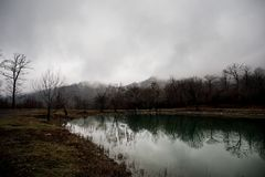 Landscape with misty morning fog in the Forest Lake or Beautiful forest lake in the morning at winter time. Azerbaijan nature. Caucasus Stock Images