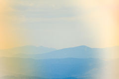 Landscape of misty mountain hills at distance. Stock Images